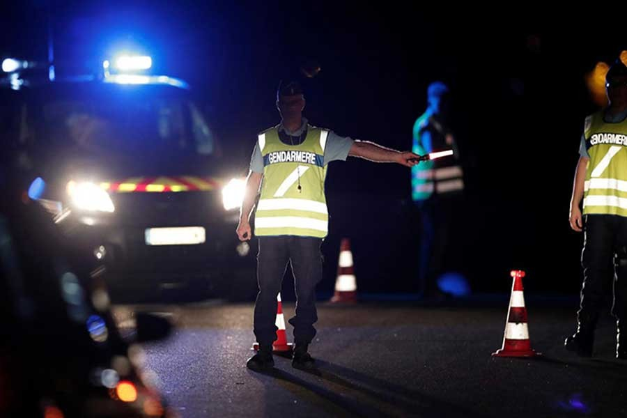 French gendarmes maintain a roadblock a certain distance from the scene where a car ploughed into the outdoor terrace of a pizzeria on Monday.