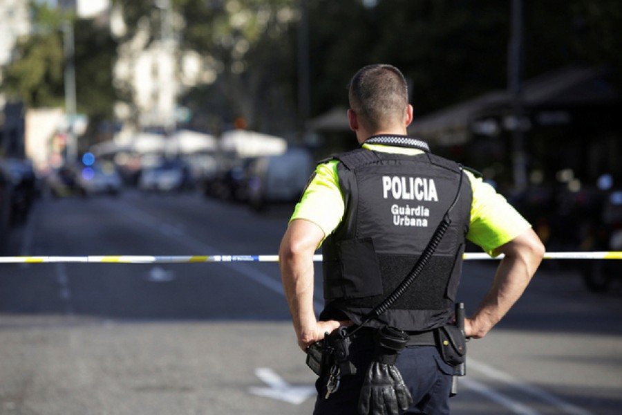 A police officer mans a cordon after the van attack in Barcelona. - Reuters file photo