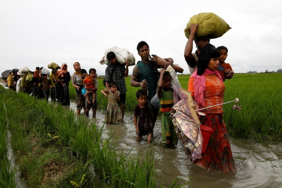 Rohingyas fleeing to Bangladesh say a campaign of arson and killings by the Myanmar army is aimed at trying to force them out