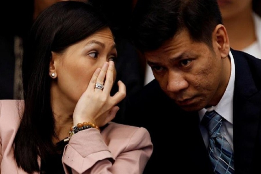 Maia Santos Deguito, a branch manager of the RCBC whispers to her lawyer during a Senate hearing on Bangladesh Bank cyber heist in Manila April 12, 2016. Reuters/ File Photo