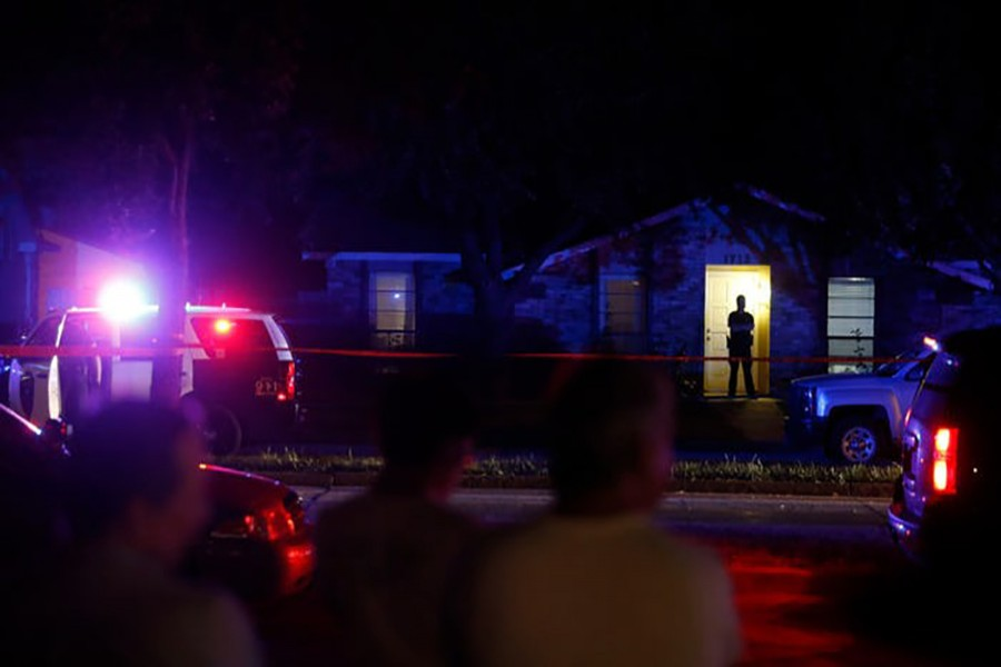 Police work the scene of a fatal shooting in Plano, a suburb north of Dallas on Sunday night. - Internet photo
