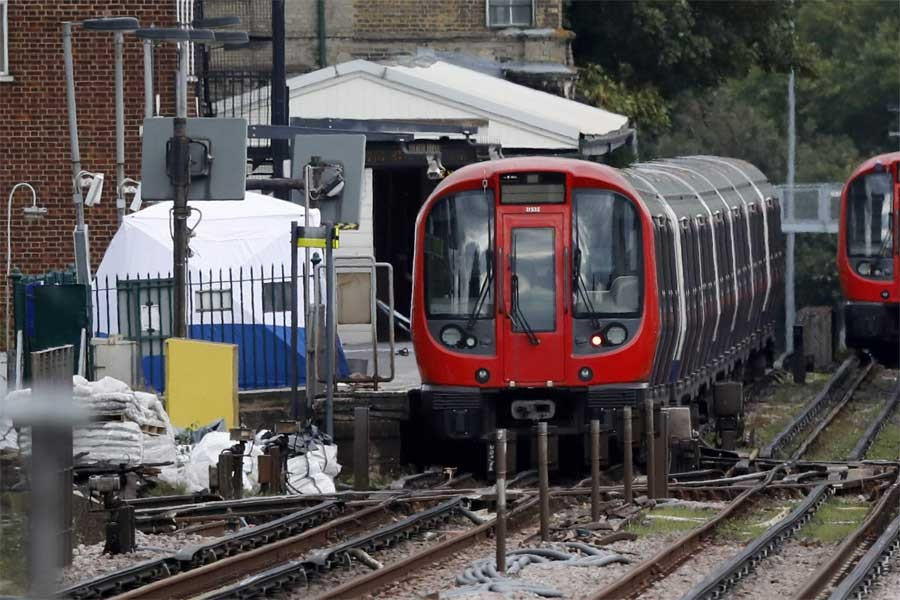 A police forensic tent stands setup on the platform next to the train on which a homemade bomb exploded at Parsons Green subway station in London (AP)
