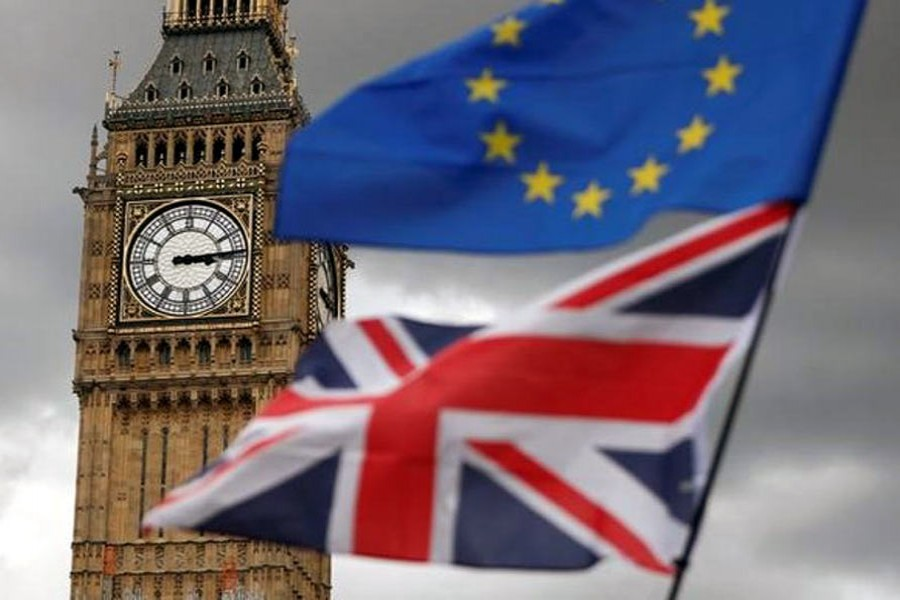 The Union Flag and a European Union flag fly near the Elizabeth Tower - Reuters Photo.