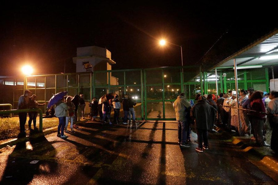 Relatives of inmates wait for news of their loved ones outside the Cadereyta state prison after a riot broke out at the prison, in Cadereyta Jimenez, on the outskirts of Monterrey, Mexico on Tuesday. - Reuters