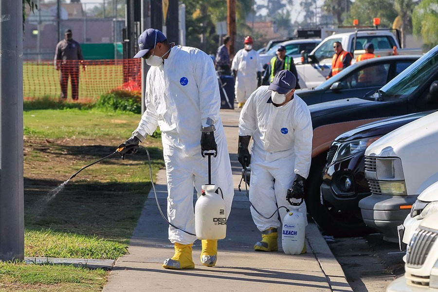 Work crews spray a bleach solution at North Park Community Park on October 13 as part of the battle against the hepatitis A outbreak in San Diego.  Photo courtesy: Los Angeles Times