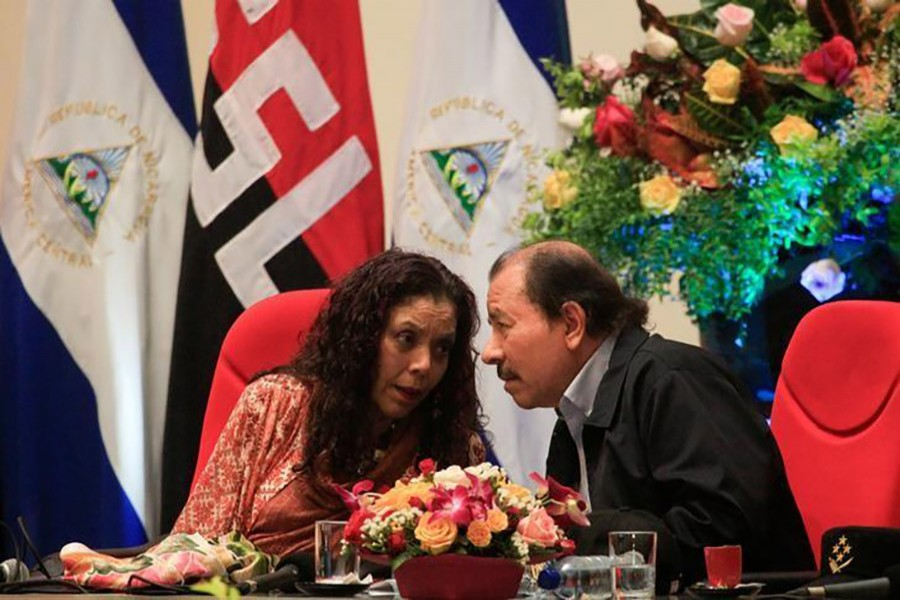 Nicaragua's president Daniel Ortega speaks with his wife and vice-president Rosario Murillo during an event on September 1 last. - Reuters file photo