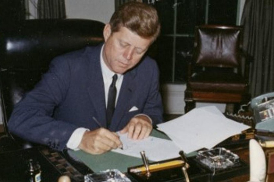US President John F. Kennedy signs a proclamation for the interdiction of the delivery of offensive weapons to Cuba during the Cuban missile crisis, at the White House in Washington, DC in 1962. - Reuters
