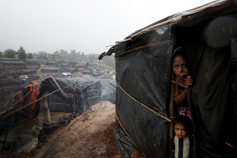 Rohingya refugees look out from a shelter in Cox's Bazar. - Reuters file photo
