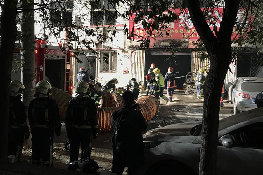 Firefighters work at the site of a fire in Daxing District of Beijing, capital of China on Saturday. - Xinhua photo