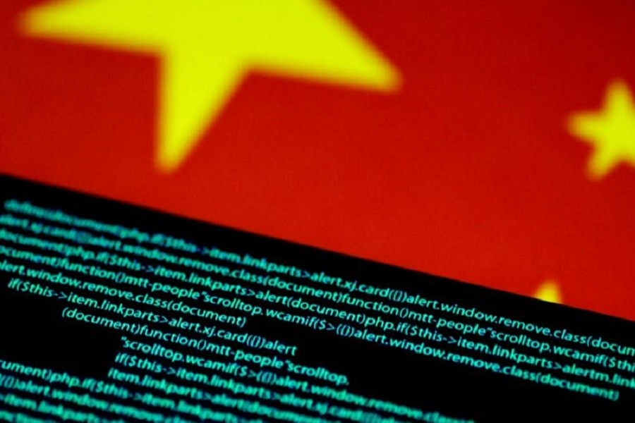 Computer code is seen on a screen above a Chinese flag in this July 12, 2017 illustration photo. Reuters/Illustration/Files