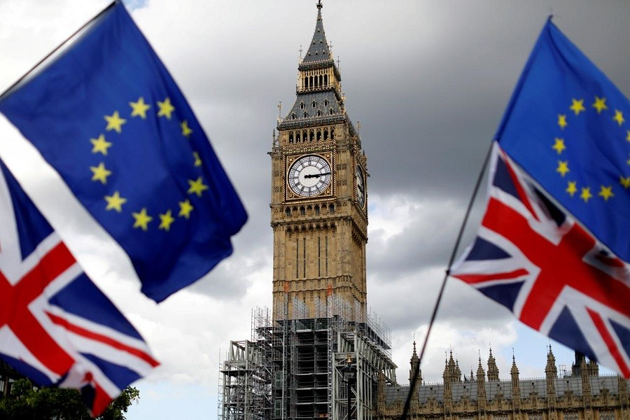 Union Flags and European Union flags fly near the Elizabeth Tower, housing the Big Ben bell, in Parliament Square in central London, Britain, September 9, 2017. Reuters/File Photo