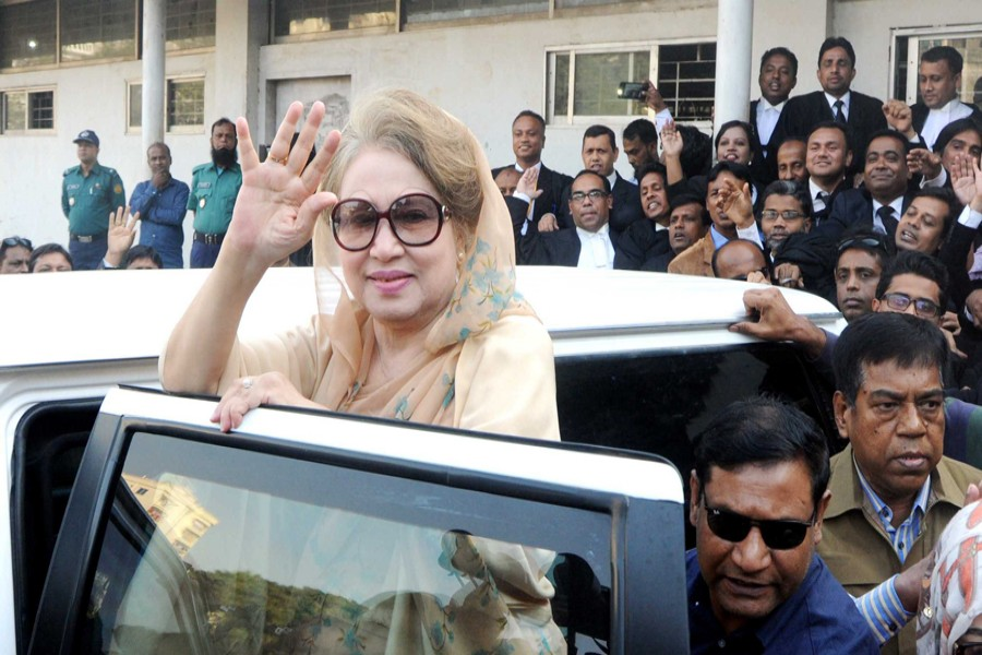 BNP Chairperson Khaleda Zia waves to party supporters after appearing before a special judge's court at Bakshibazar in the city on Tuesday in the Zia Orphanage Trust and Zia Charitable Trust graft cases. — Focus Bangla
