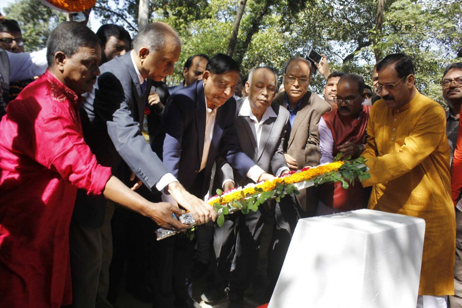 Disaster Management and Relief Minister Mofazzal Hossain Chowdhury Maya places a wreath at a monument at Suhrawardy Uddyan