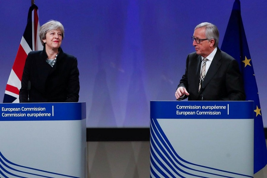 Britain's Prime Minister Theresa May and European Commission President Jean-Claude Juncker leave after making statements at the European Commission in Brussels, Belgium, December 4, 2017. Reuters
