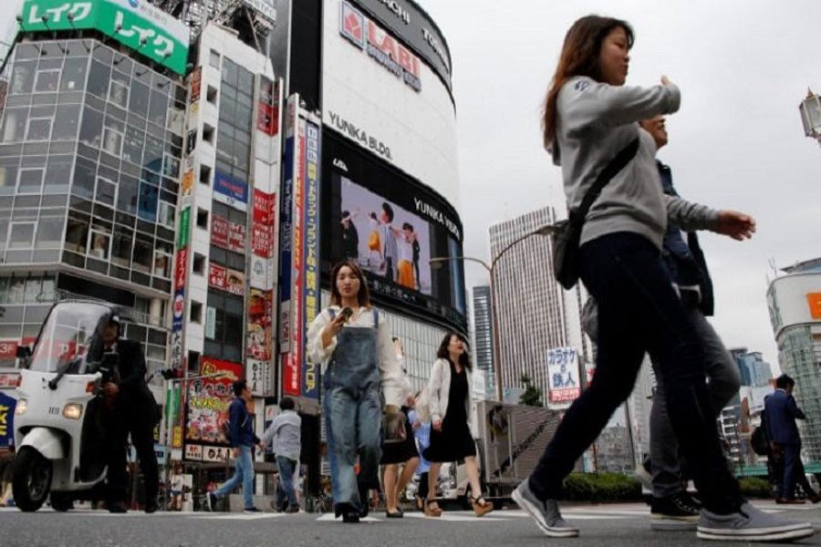 People cross the street at a shopping district in Tokyo, Japan, September 8, 2016. Reuters/File Photo