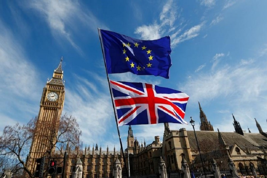 EU and Union flags fly above Parliament Square during a Unite for Europe march, in central London, Britain March 25, 2017. Reuters/File Photo