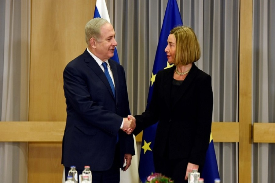 EU foreign policy chief Federica Mogherini shakes hands with Israeli Prime Minister Benjamin Netanyahu at the European Council headquarters in Brussels, Belgium, Dec 11, 2017. Reuters