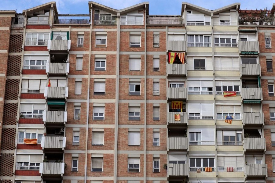Flags of Spain, Catalonia and Esteladas (Catalan separatist flag) hang from balconies and windows of a building in Barcelona, Spain, November 1, 2017. Reuters/Files