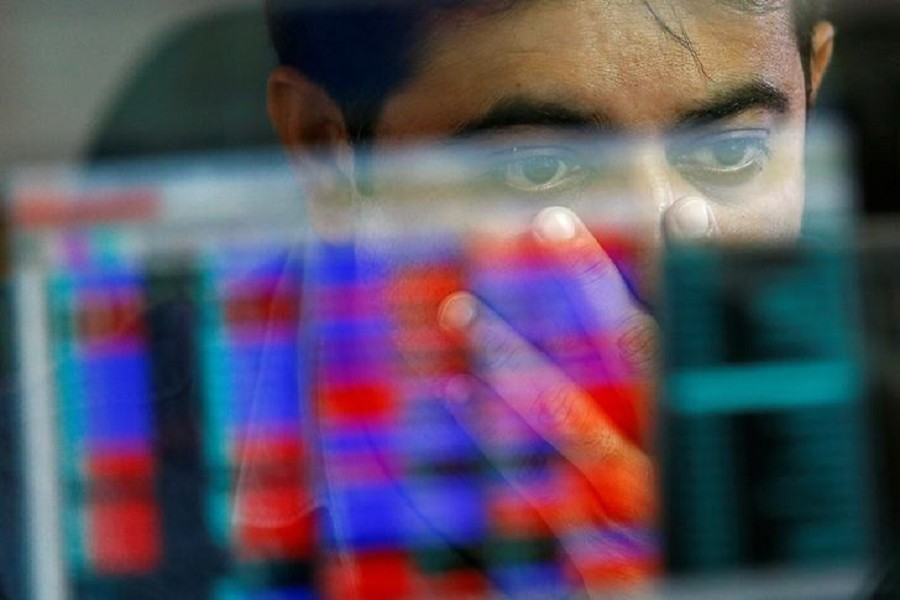 A broker reacts while trading at his computer terminal at a stock brokerage firm in Mumbai, India, November 9, 2016. Reuters/File Photo