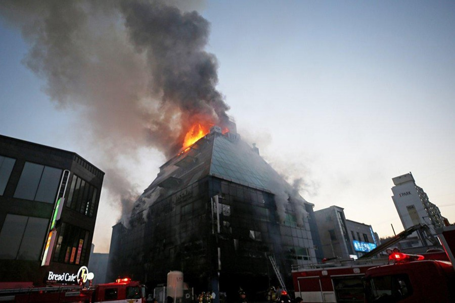 An estimated 60 firefighters battled the fire Thursday and local media showed trucks and helicopters also on the scene. - AP photo