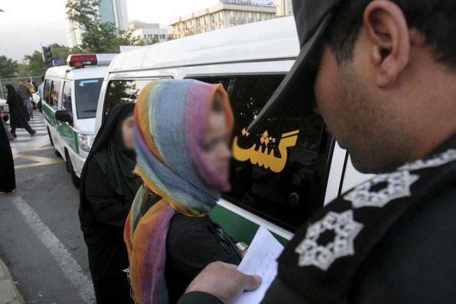 """Iran moral police take down the name of a detained woman during a crackdown on """"social corruption"""" in north Tehran in June 18, 2008. - Reuters file photo used for representation."""