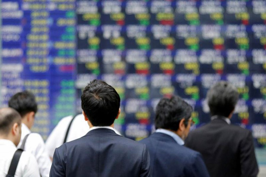 Asian shares mixed in light trading