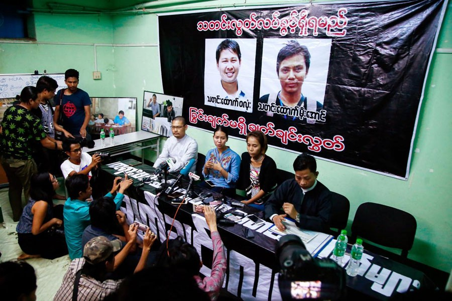 Pan Ei Mon (C-L), wife of Reuters reporter Wa Lone and Nyo Nyo Aye (C-R), sister of Reuters reporter Kyaw Soe Oo attend a news conference in Yangon, Myanmar, December 28, 2017. Reuters