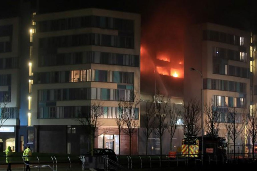 Firefighters tackle a fire during a serious blaze in a multi-storey car park in Liverpool, Britain, December 31, 2017. (REUTERS)