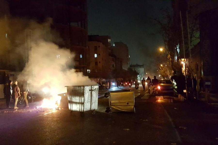 People protest in Tehran, Iran on Saturday in this picture obtained from social media. - via Reuters