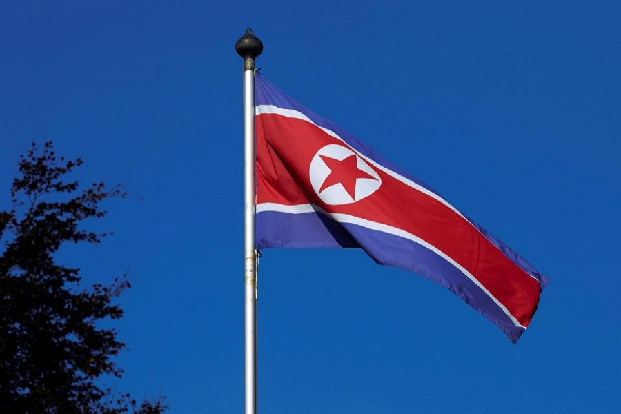A North Korean flag flies on a mast at the Permanent Mission of North Korea in Geneva October 2, 2014. Reuters/File Photo