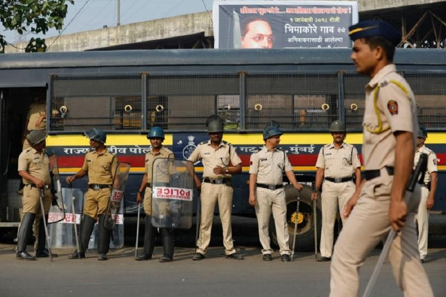 Policemen stand guard at a traffic junction in Mumbai, India, January 3, 2018. Reuters