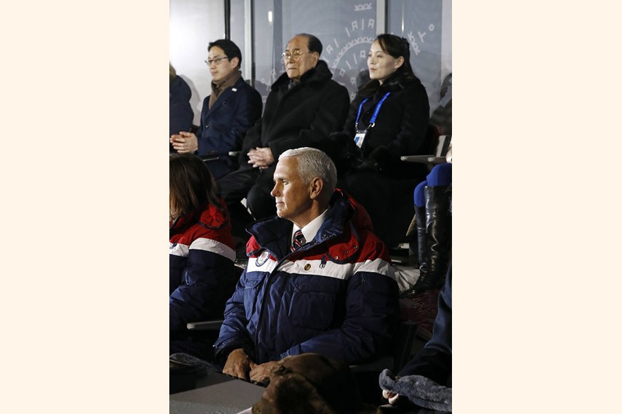 Vice President Mike Pence, bottom, watches the opening ceremony of the 2018 Winter Olympics in Pyeongchang, South Korea, Friday, Feb. 9, 2018. Seated behind Pence are Kim Yo Jong, top right, sister of North Korean leader Kim Jong Un. –AP Photo