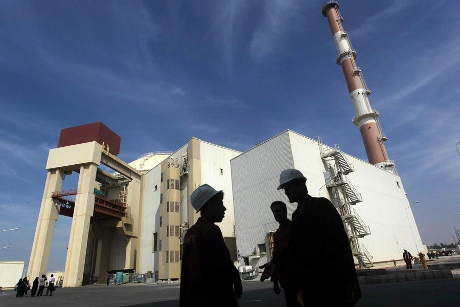 Iranian workers stand in front of the Bushehr nuclear power plant, about 1,200 km (746 miles) south of Tehran, Iran, October 26, 2010. Reuters/File Photo