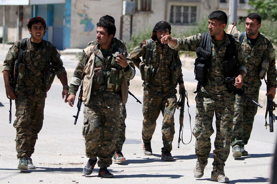 Kurdish fighters from the People's Protection Units (YPG) walk along a street in the southeast of Qamishli city, Syria, April 22, 2016. (Reuters photo used for representation)