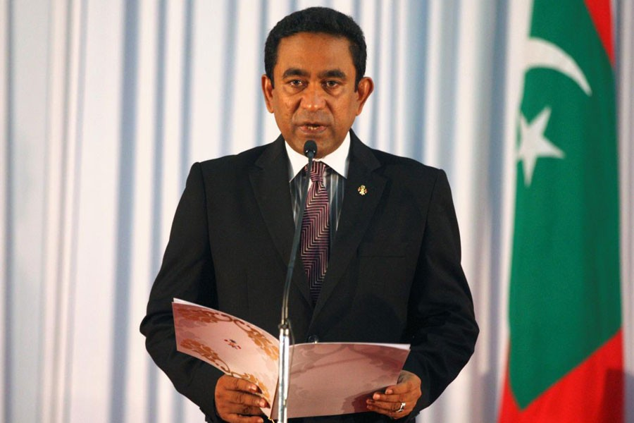 Abdulla Yameen takes his oath as the President of Maldives during a swearing-in ceremony at the parliament in Male November 17, 2013. (Reuters)
