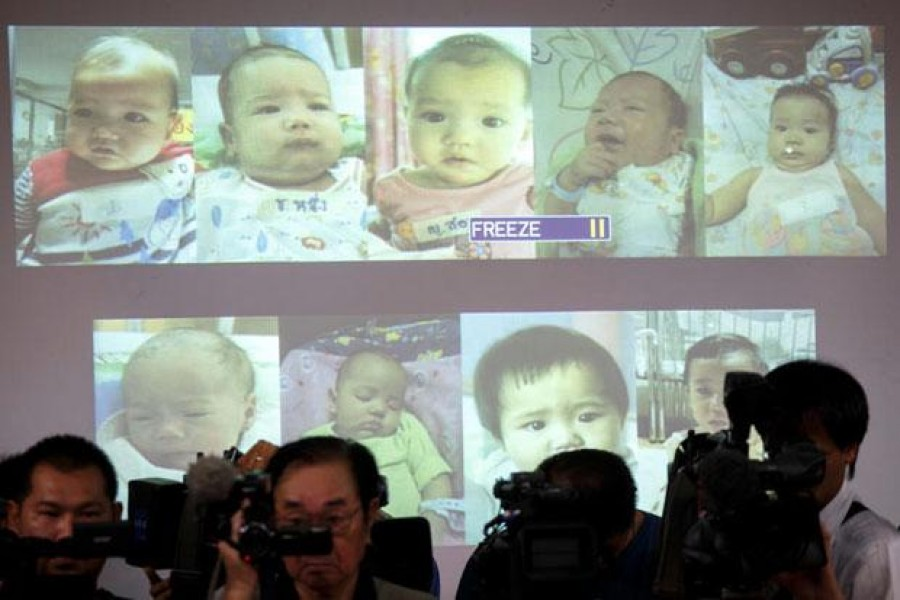 In this Reuters file photo, surrogate babies that Thai police suspect were fathered by a Japanese businessman who then fled from Thailand are shown on a screen during a news conference at the headquarters of the Royal Thai Police in Bangkok August 12, 2014. - bangkokpost.com