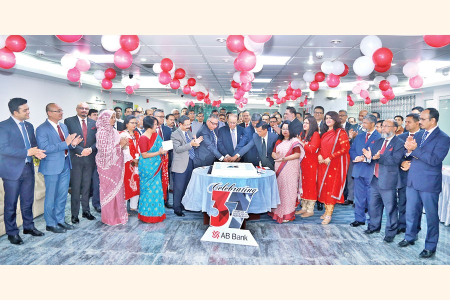M Morshed Khan, Founder Chairman of AB Bank Limited, along with directors and Tarique Afzal, President & Managing Director (Current Charge) of the bank, cutting a cake at a programme marking the 37th founding anniversary of the bank at its head office in the city recently