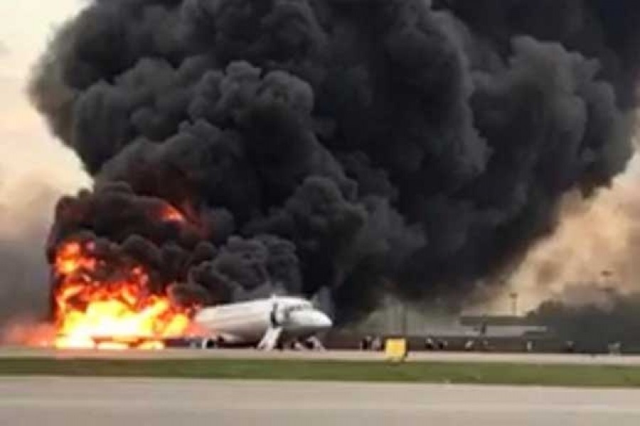A passenger plane is seen on fire after an emergency landing at the Sheremetyevo Airport outside Moscow, Russia May 5, 2019. The Investigative Committee of Russia/Handout via Reuters