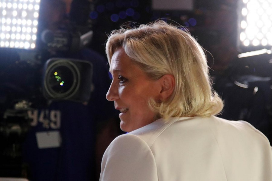 French far-right National Rally (Rassemblement National) party leader Marine Le Pen talks to the media after the first results in Paris, France, May 26, 2019. Reuters