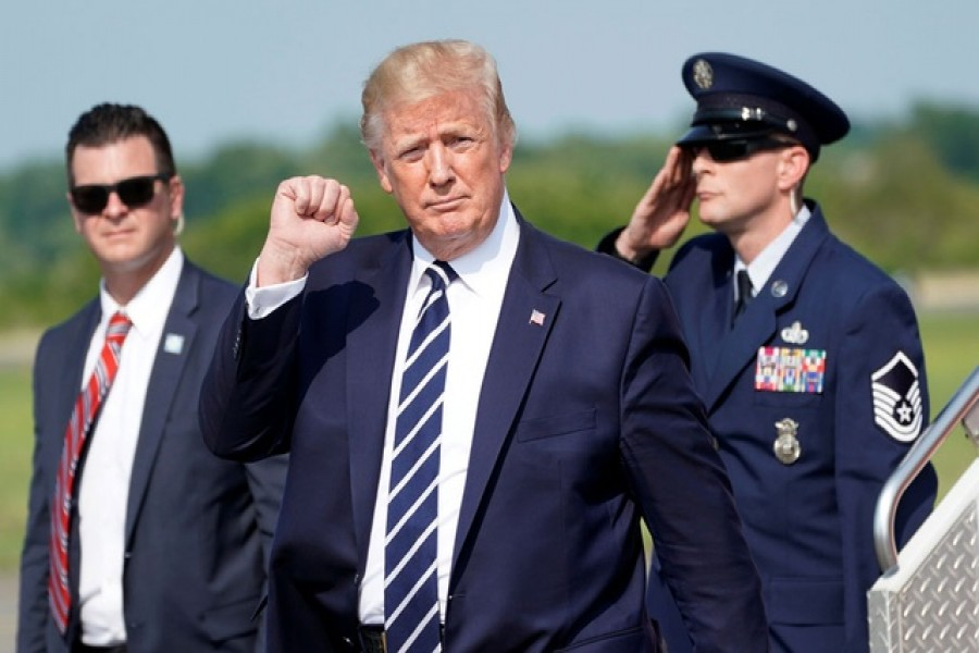US President Donald Trump pumps his fist as he arrives in Morristown to spend the weekend at his golf club in nearby Bedminster, New Jersey, US, July 19, 2019. Reuters
