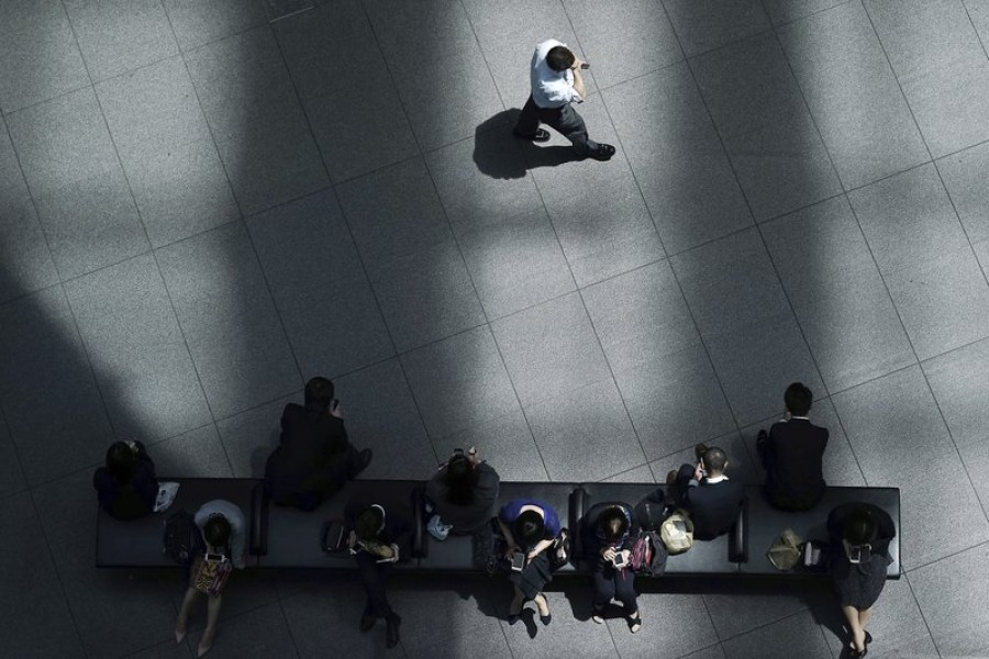 In this May 10, 2019, photo, a man walks in shade of a building as other people rest at a bench in Tokyo - AP Photo/Eugene Hoshiko