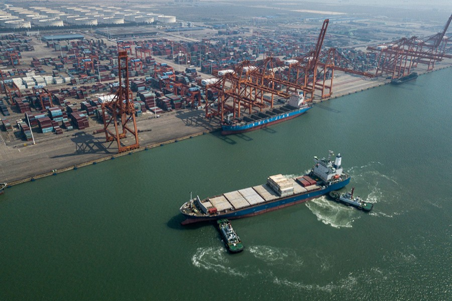 Aerial photo taken on November 3, 2018 shows ships at a dock in Qinzhou Free Trade Port Area, south China's Guangxi Zhuang Autonomous Region — Xinhua/Files