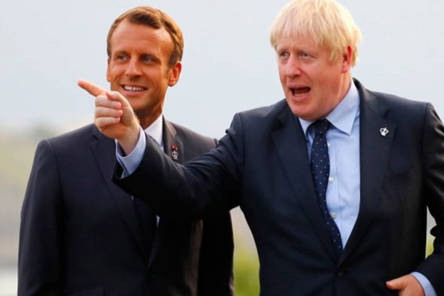 French President Emmanuel Macron, left, welcomes Britain's Prime Minister Boris Johnson at the Biarritz lighthouse, southwestern France, ahead of a working dinner Saturday, August 24, 2019. AP
