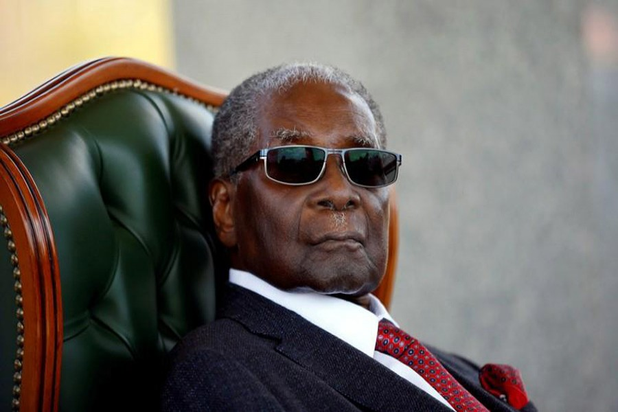 """Zimbabwe's former president Robert Mugabe looks on during a press conference at his private residence nicknamed """"Blue Roof"""" in Harare, Zimbabwe, July 29, 2018. Reuters/Files"""