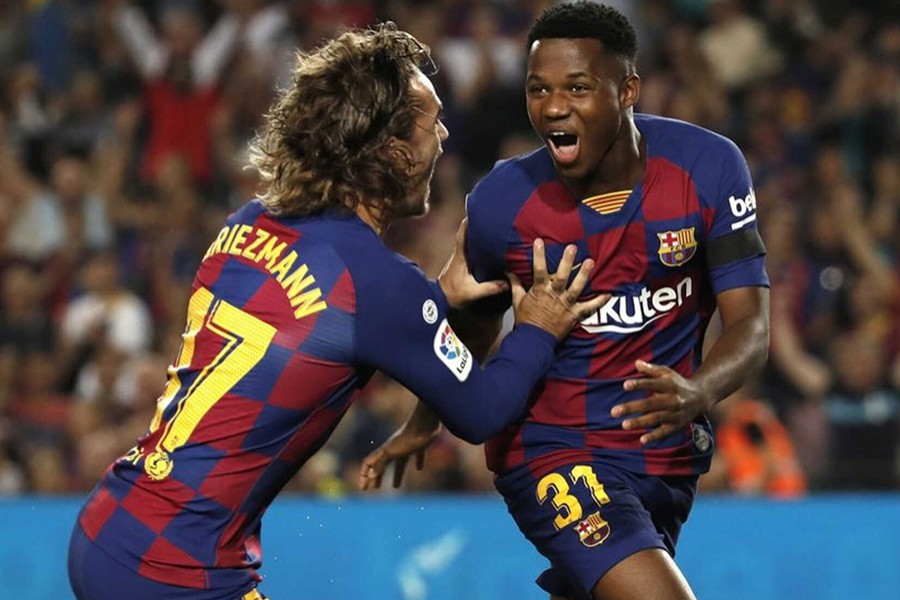 Barcelona's Ansu Fati celebrates scoring their first goal with teammate Antoine Griezmann during the clash against Valencia at Camp Nou in Barcelona on September 14, 2019 — Reuters photo