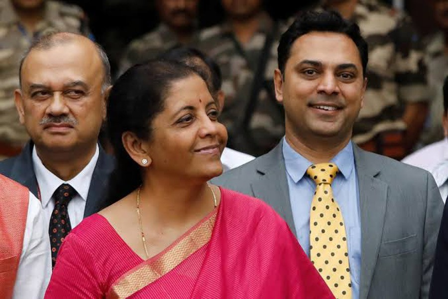 Finance Minister Nirmala Sitharaman (C) and Krishnamurthy Subramanian (R), chief economic adviser pose during a photo opportunity outside their office before the presentation of the federal budget in the parliament in New Delhi, India, July 5, 2019. Reuters/Files