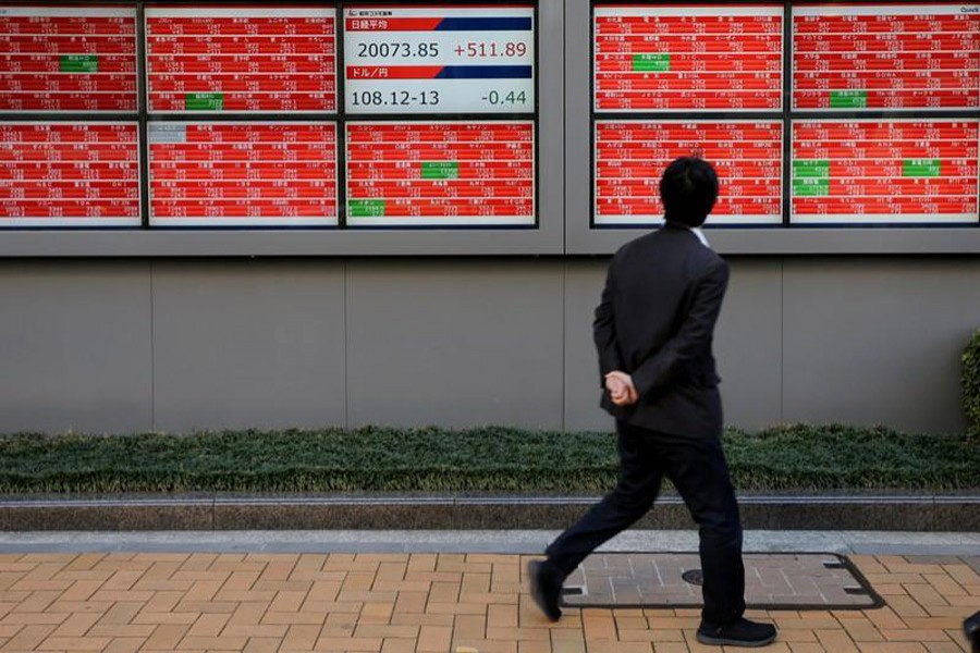 A man looks at an electronic board showing the Nikkei stock index outside a brokerage in Tokyo, Japan, January 7, 2019. Reuters/Files
