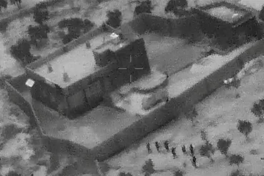 US special forces move towards the compound of Islamic State leader Abu Bakr al-Baghdadi during a raid in the Idlib region of Syria in a still image from video October 26, 2019. Video picture taken October 26, 2019. US Department of Defense/Handout via REUTERS