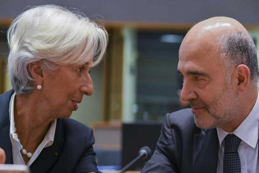 Christine Lagarde (L), President of the European Central Bank, talks with European Commissioner for Economic and Financial Affairs, Taxation and Customs Pierre Moscovici before the Eurogroup meeting in Brussels, Belgium, on Nov. 7, 2019. The European Commission said on Thursday that euro area gross domestic product (GDP) is forecast to expand by 1.1 per cent in 2019 and by 1.2 per cent in 2020 and 2021. Compared with the projections the European Union's executive arm published in July, the growth forecast has been downgraded by 0.1 percentage points for 2019 and 0.2 percentage points for 2020. (Photo by Riccardo Pareggiani/Xinhua)