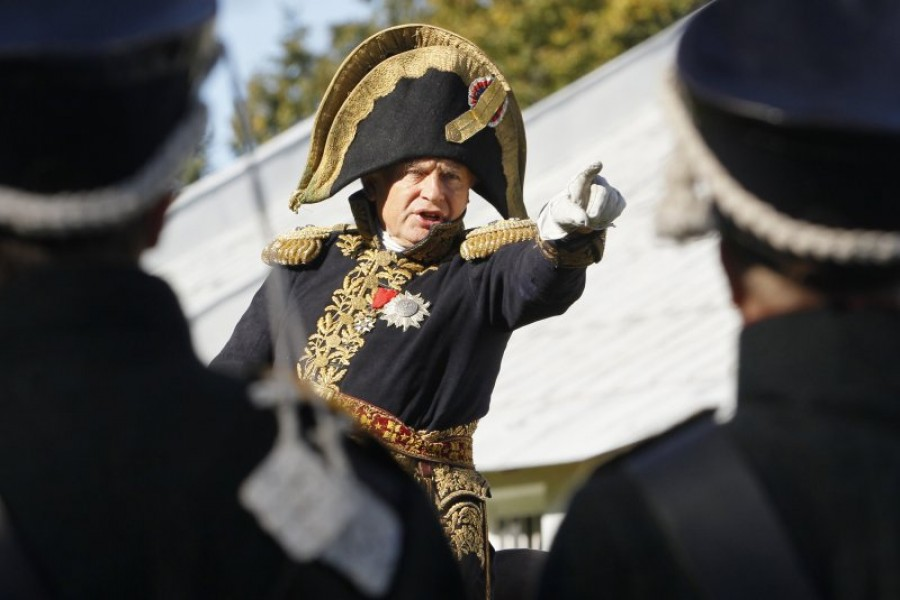 In this Sunday, Sept. 16, 2012 file photo, Oleg Sokolov, a history professor at St. Petersburg State University, wears a 1812-era French army general's uniforms during a staged battle re-enactment to mark the 200th anniversary of the battle of Borodino which in 1812 was the largest and bloodiest single-day action of the French invasion of Russia, in St. Petersburg, Russia. Dmitri Lovetsky—AP